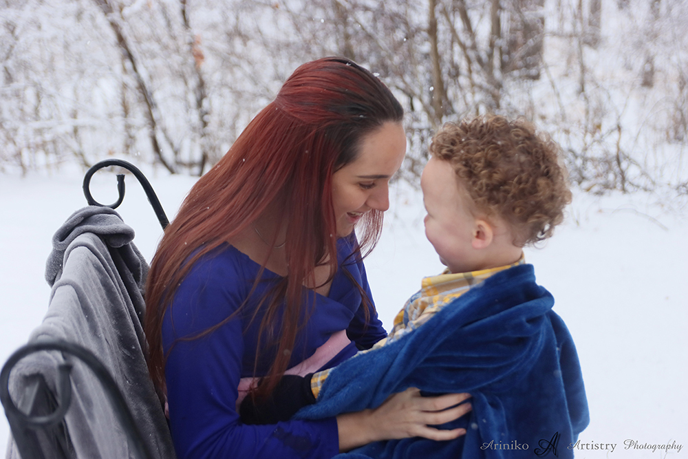 Mother and son posing during a maternity session at Harris Nature Center in Okemos, Michigan